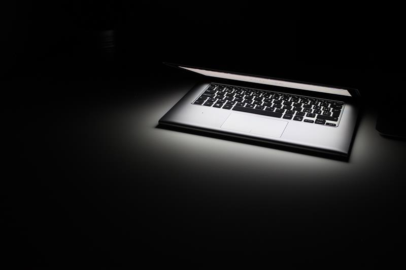 Glowing laptop and keyboard