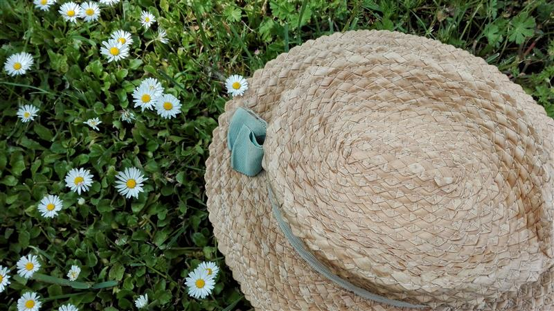 Straw hat lying on the grass