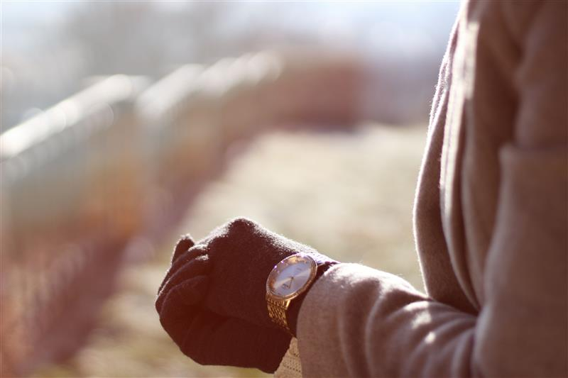 Woman hands and watch in winter