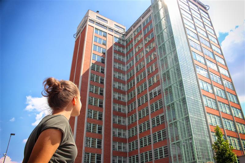 Young woman looking at building in the city