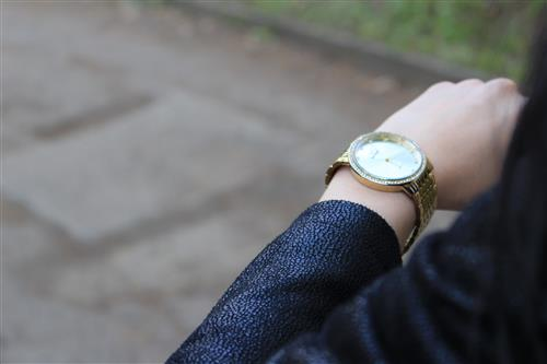 Woman checking her watch