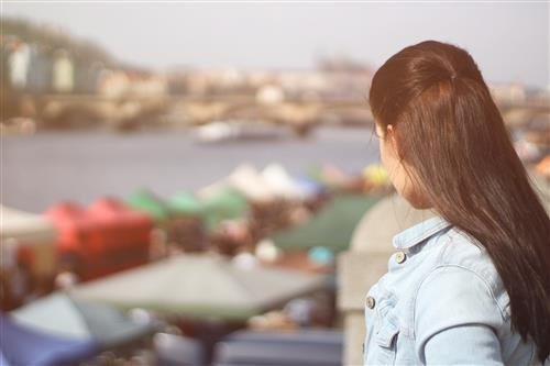 Woman staring at outdoor market
